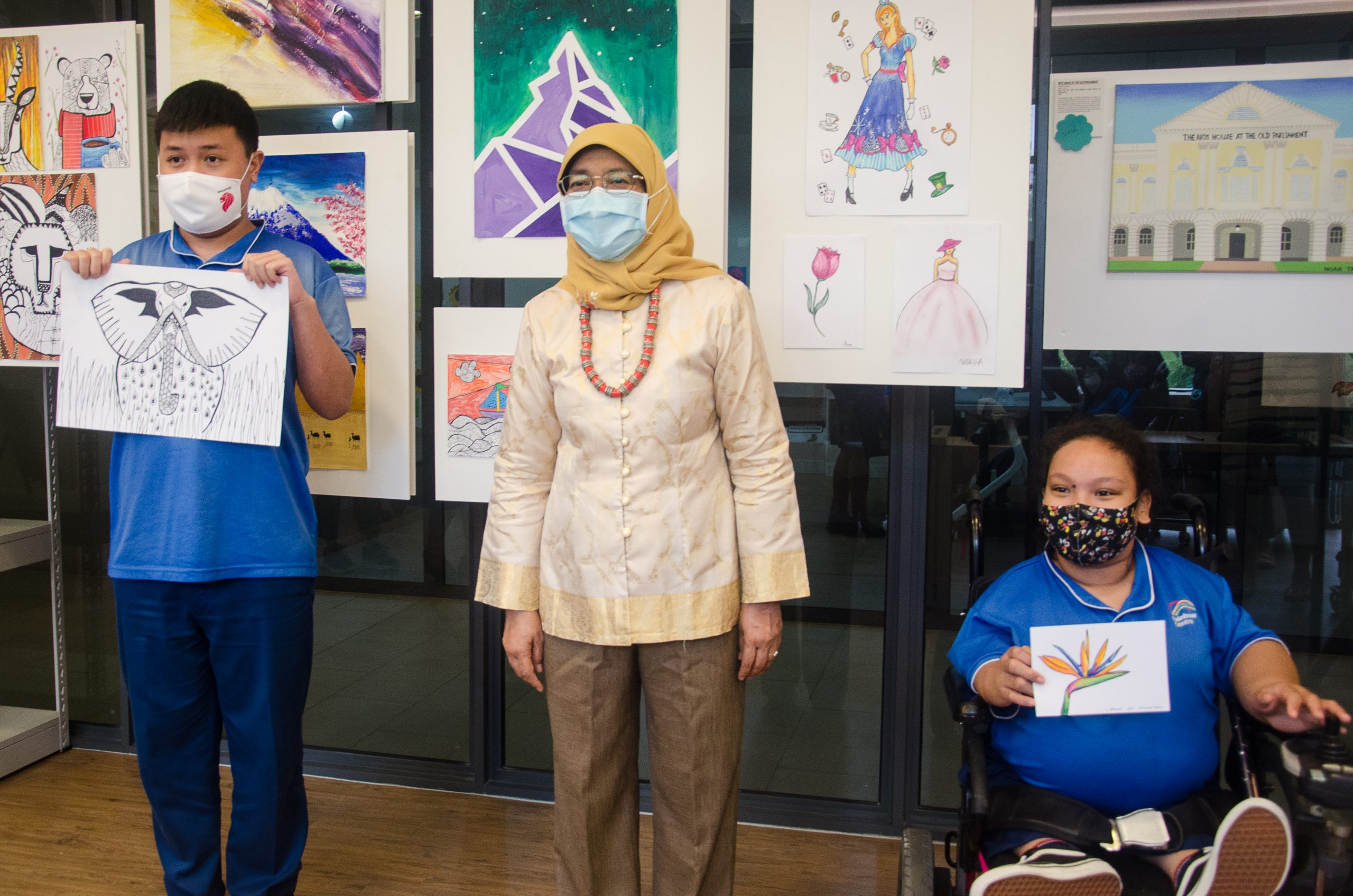Naufal and Nuralysya pose with President Halimah Yacob during her visit to our Margaret Drive campus.