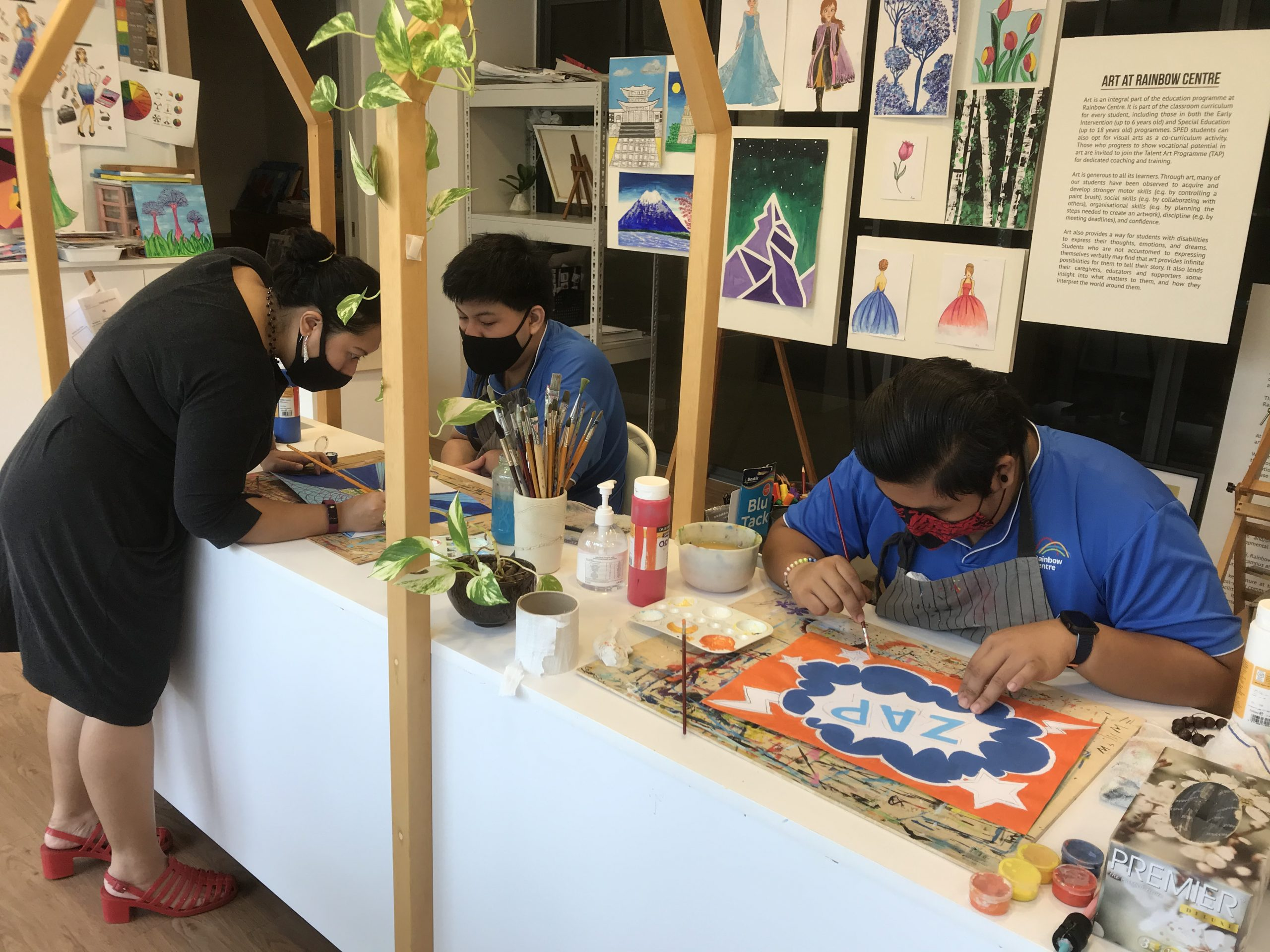 Artability apprentices working on their creations in our Canvas studio.